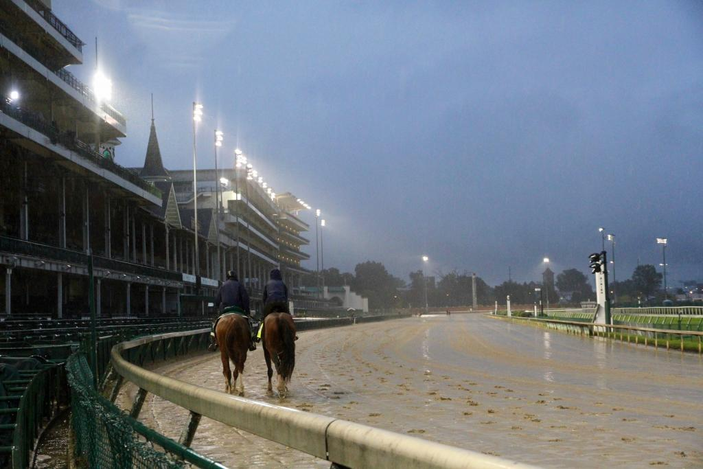 Tiz the Law jogs under the Twin Spires of Churchill Downs Thursday morning (Annise Montplaisir/America's Best Racing)