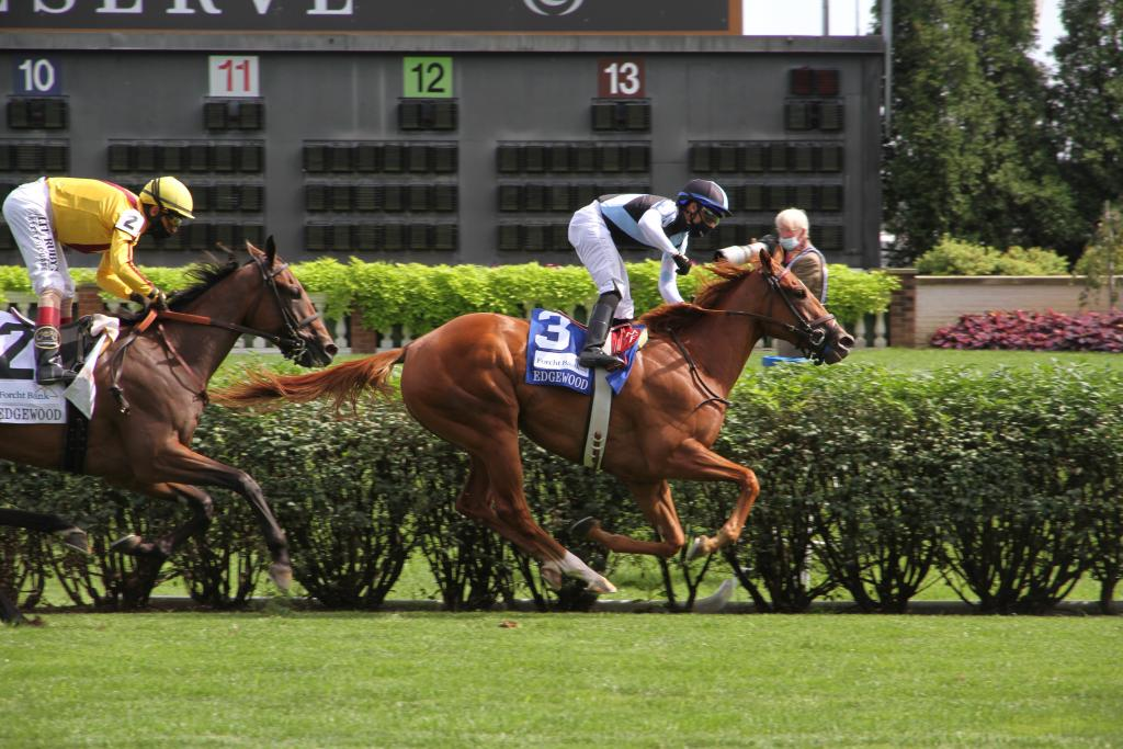 Sharing winning the Edgewood Stakes. (Annise Montplaisir/America's Best Racing)