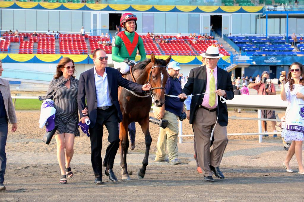 Barry Irwin (in hat) and Team Valor connections head to the winner's circle. (Penelope P. Miller/America's Best Racing)