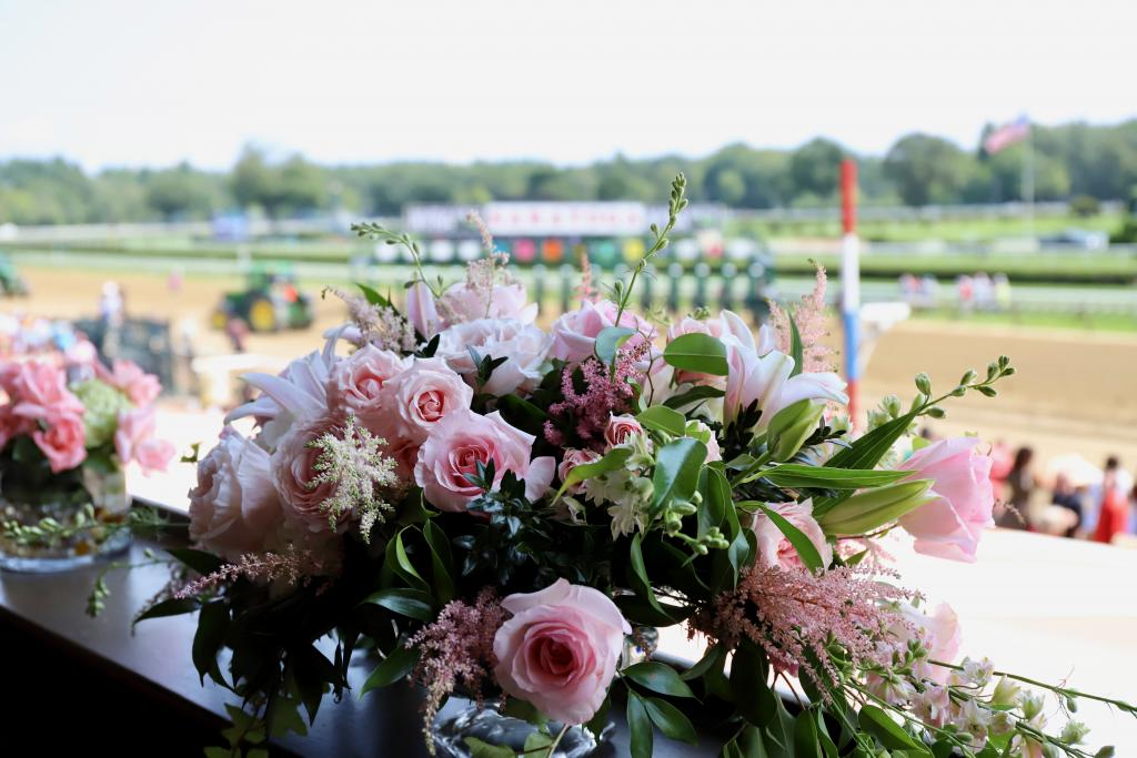 """Flowers honoring Marylou Whitney in her Saratoga Race Course box on Whitney Stakes day Aug. 3. Whitney, the """"Queen of Saratoga,"""" died July 19 and was inducted into the Racing Hall of Fame as a Pillar of the Turf Aug. 2. (Penelope P. Miller/America's Best Racing)"""