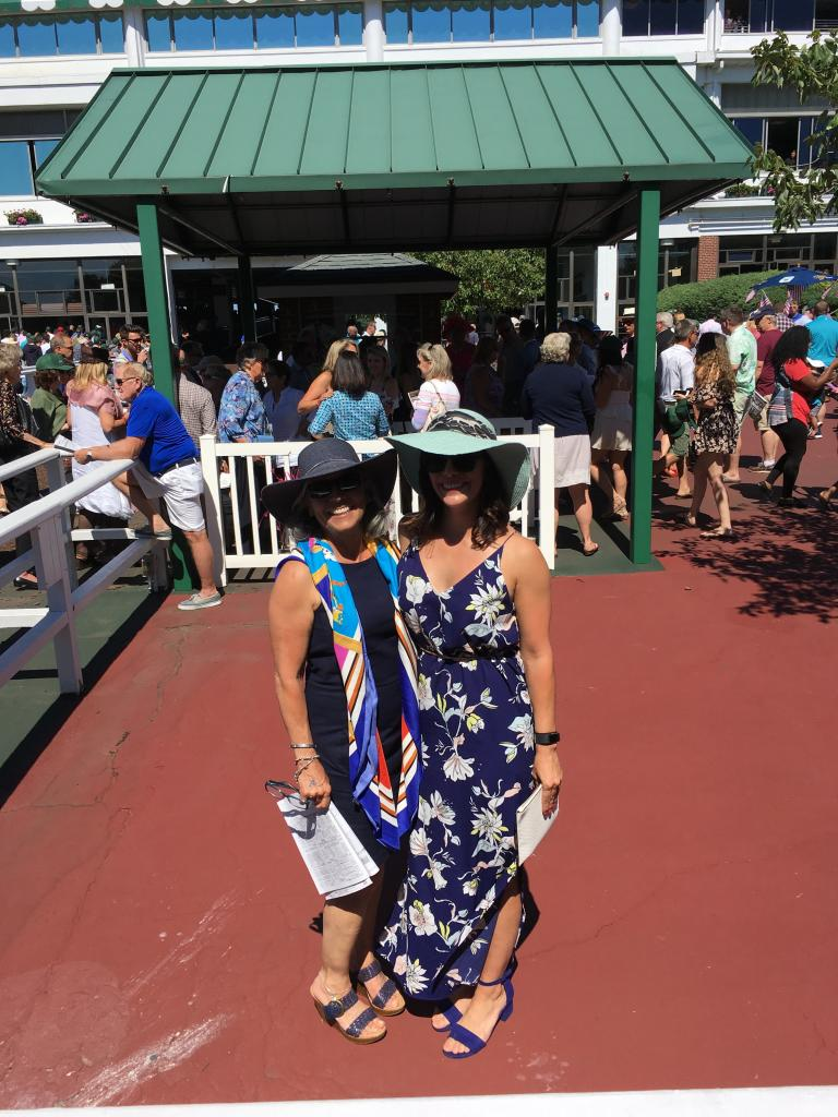 Former jockey Andrea Sgro (left), who rode at Monmouth Park in the 1970s and '80s, traded in her racing silks and now looks stylish in a silk scarf. She attended with her daughter Ali. (Pia Catton photo)