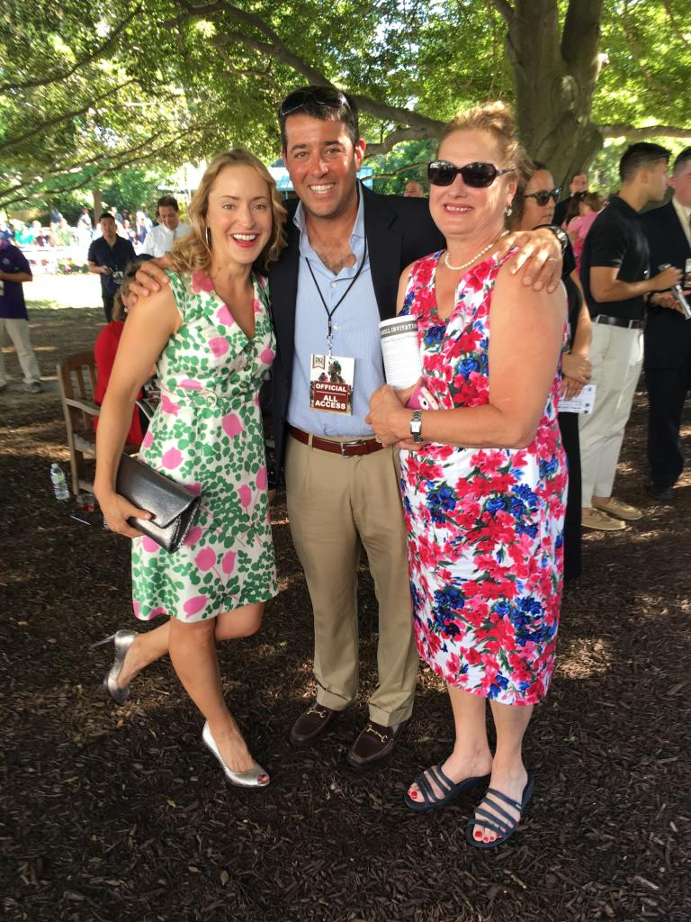 Winning owner of the 2016 Preakness Stakes Sol Kumin shares a moment in the paddock with friend Sarah (left) and Julie, who are not afraid to rock the colorful prints. (Pia Catton photo)