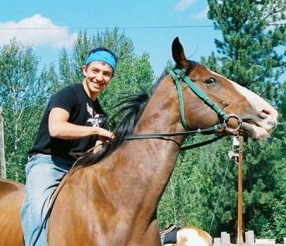 Jake as a teenager and his Omak Stampede horse, Eagle Boy, the first horse that he ran down the hill (Courtesy of Kassie Guglielmino)