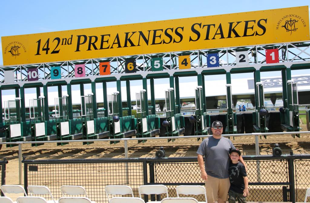 Jesse Fikes and son Michael at the Pimlico starting gate. (Julie June Stewart photo)
