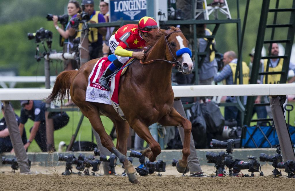 Justify wins the Belmont Stakes and with it, the Triple Crown. (Eclipse Sportswire)