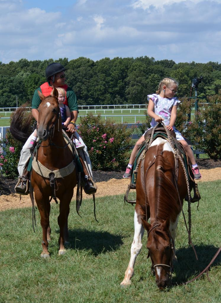 A true family affair, before the first race the ponies had a few smaller riders on them in the paddock. (Melissa Bauer-Herzog/America's Best Racing)