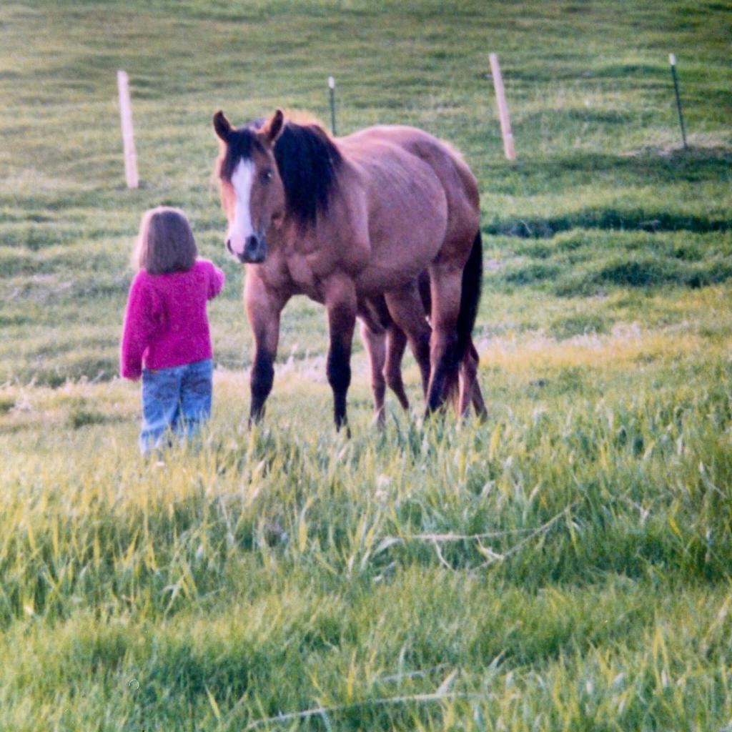 Kassie, age 4, and her horse Lena who is now 26. (Courtesy of Kassie Guglielmino)