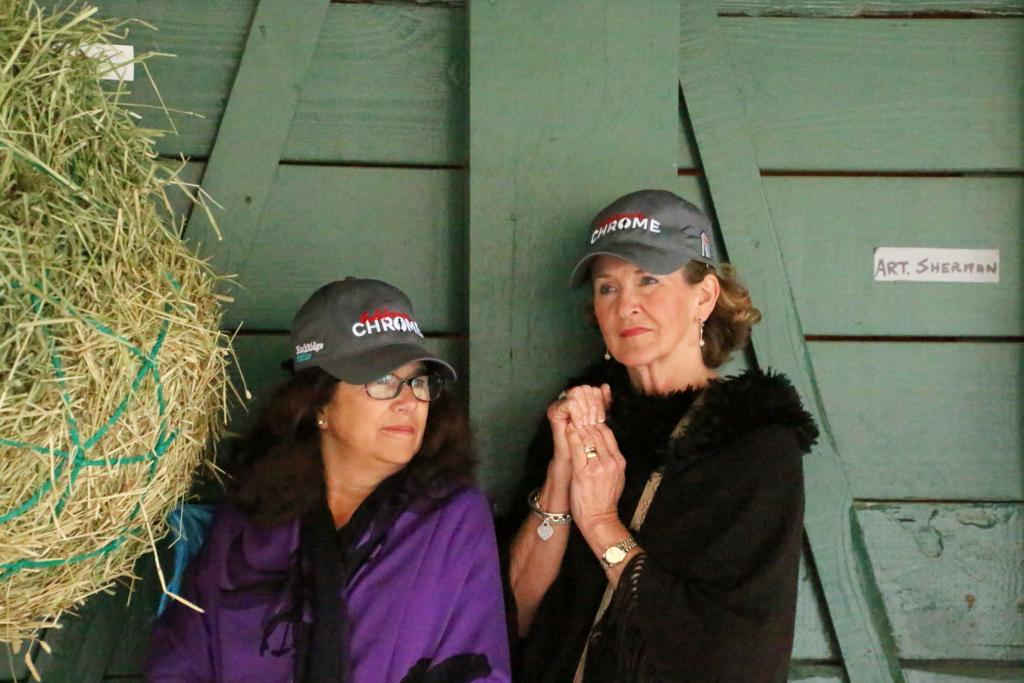 Cheryl Hoffman, left, and Zella May Daugherty, right, stand next to California Chrome's stall. (Julie June Stewart photo)