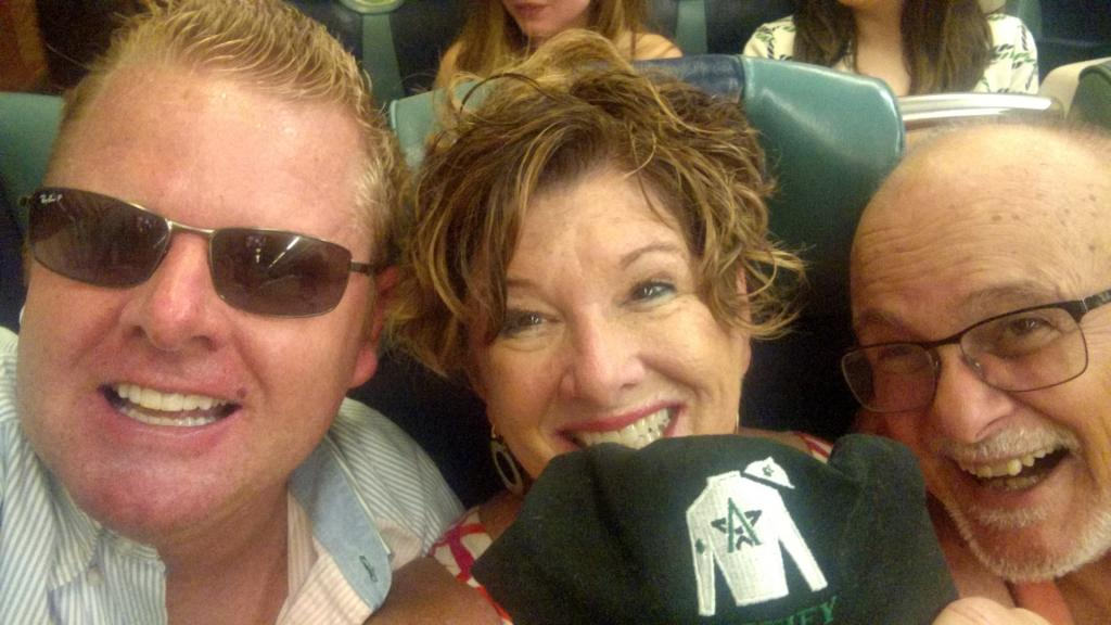 Ben Roeger, Libby Ludwig, and Terry Ludwig with a Justify hat (Photo courtesy Libby Ludwig)