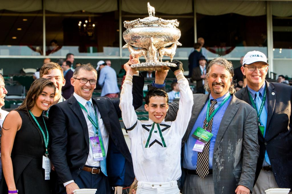 WinStar owner Kenny Troutt, Ortiz, Asmussen and Walden with the Belmont trophy. (Eclipse Sportswire)