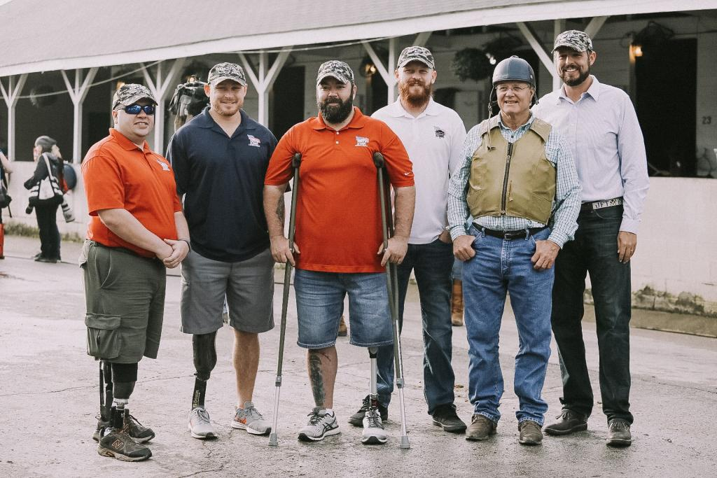 Veterans with Bill Mott, second from right, and Jacob Tamme, far right. (Photo courtesy of Sentient Jet)