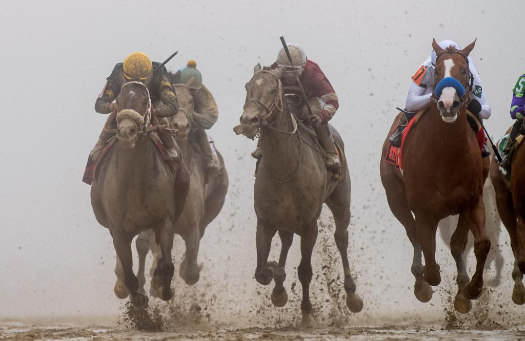 Justify, inside, has the lead in deep stretch of the Preakness. (Eclipse Sportswire)