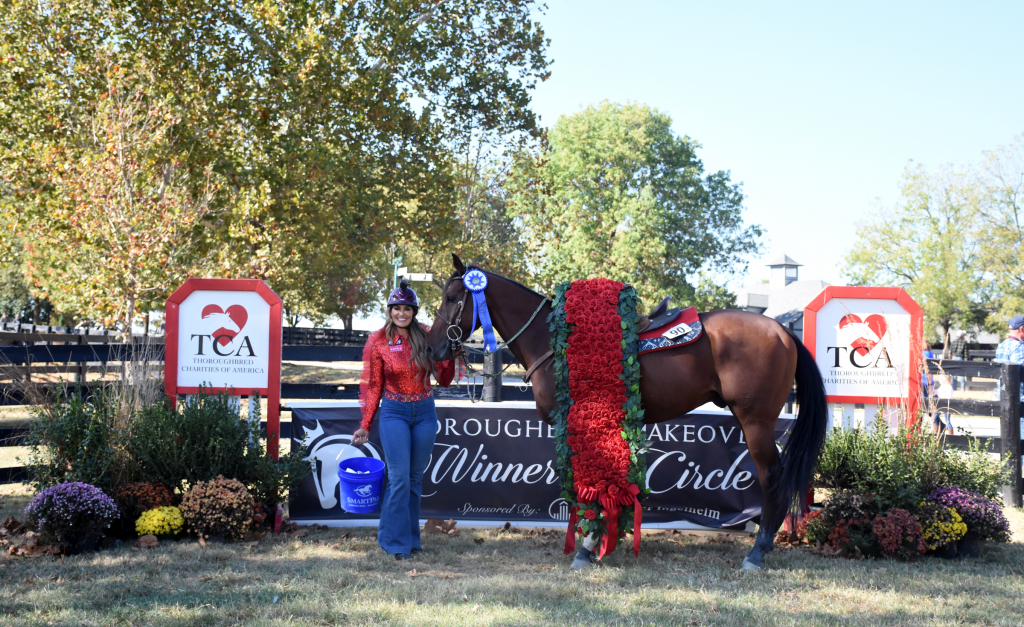 Fallon Taylor with 2019 Thoroughbred Makeover Champion Cowboy Swagger. (Melissa Bauer-Herzog/America's Best Racing)