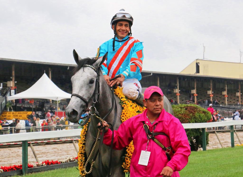 Red Ruby and Paco Lopez wearing the traditional garland of Black-Eyed Susans after winning the Black-Eyed Susan Stakes. (Julie June Stewart photo)