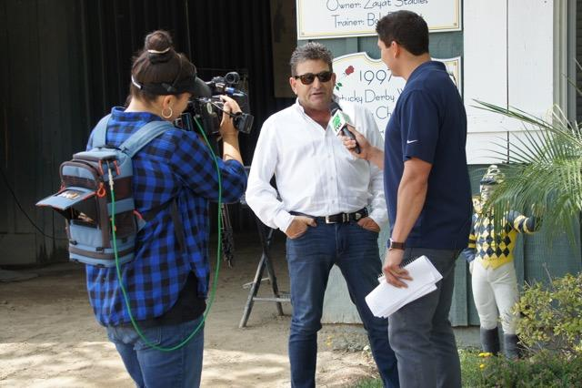 Assistant trainer Jimmy Barnes is interviewed by TVG. (Cynthia Holt photo)