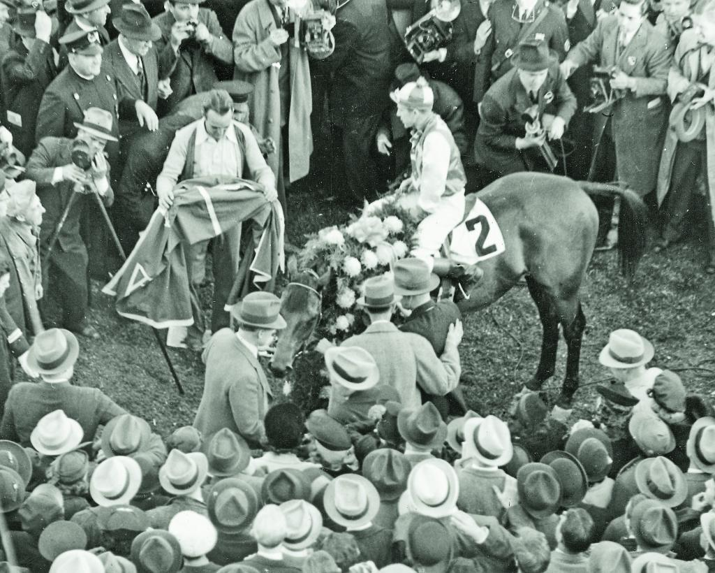 Seabiscuit and jockey George Woolf in the winner's circle after match against War Admiral at Pimlico. (Joe Fleischer/Blood-Horse photo)