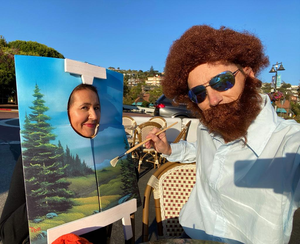 Steve dressed for 2020 Halloween as painter Bob Ross with Tonya as his painting. (Photos courtesy of Steve Melen)