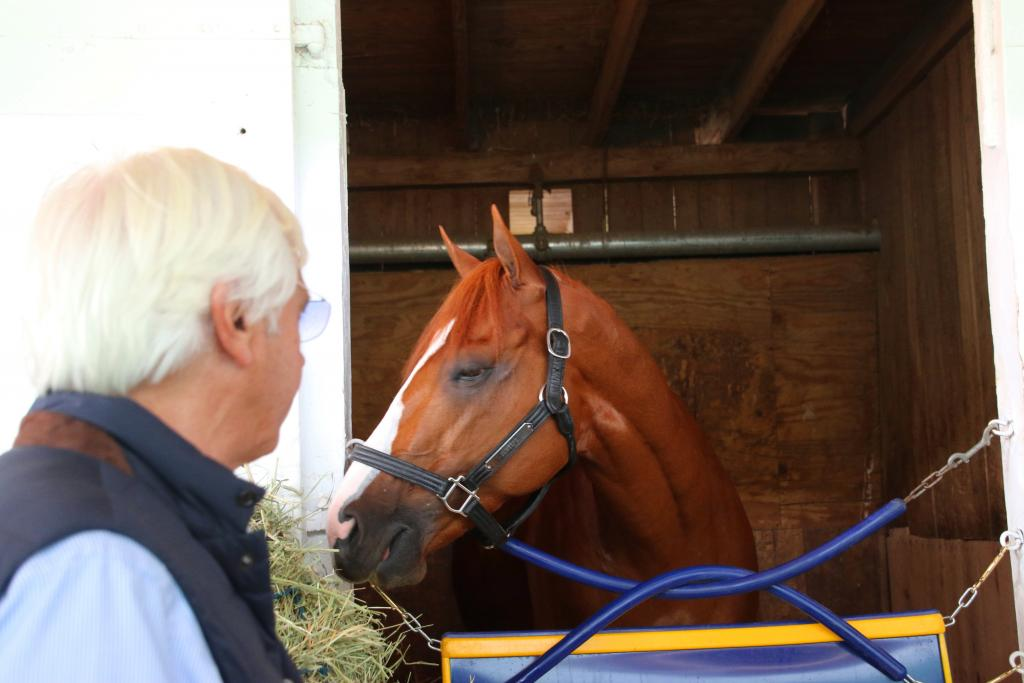 Two days before the Kentucky Derby, Baffert and Justify share a quiet moment in the barn. (Julie June Stewart photo)