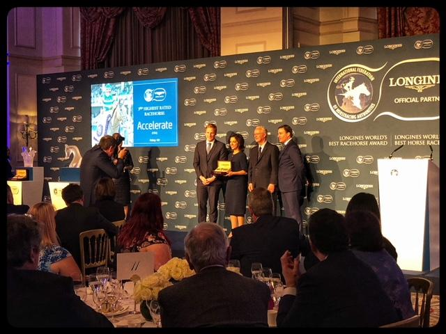 Stephanie Hronis, co-owner of Accelerate, accepting third-place award for World's Best Racehorse (America's Best Racing photo)