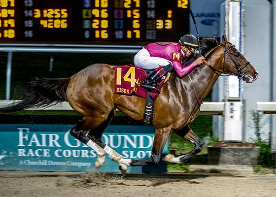 War of Will winning the Risen Star Stakes. (Lou Hodges, Jr. /Hodges Photography)