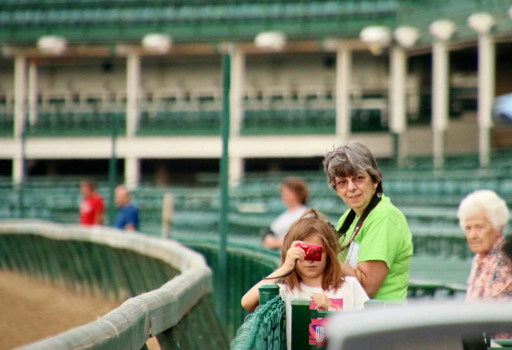 A young fan takes photos of morning workouts. (Julie June Stewart photo)