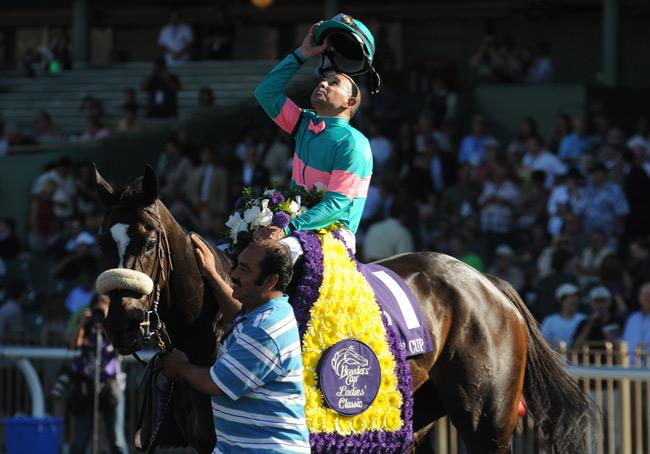 Mike Smith celebrates after winning the Breeders' Cup Distaff on Zenyatta. (Eclipse Sportswire)