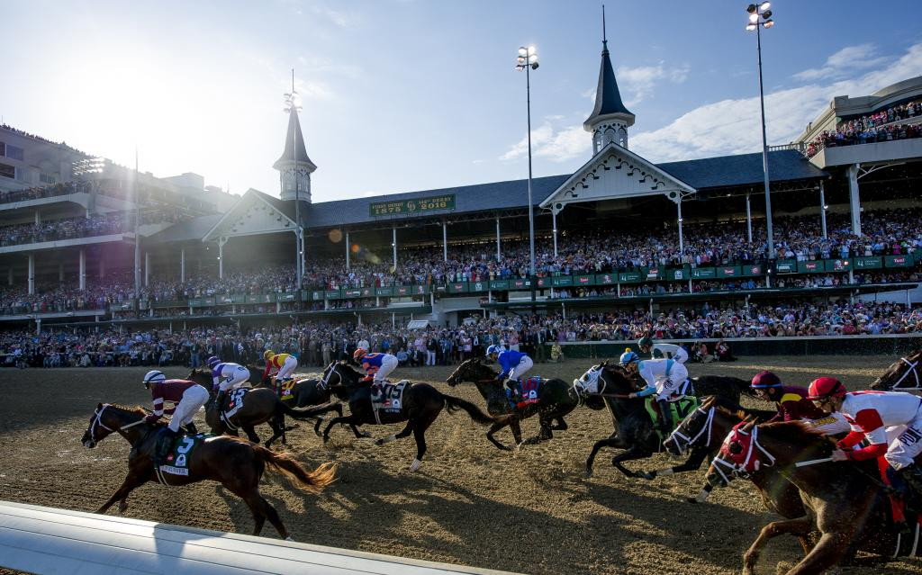 The field races past the grandstand for the first time in the 2016 Kentucky Derby on May 7 at Churchill Downs. (Eclipse Sportswire)