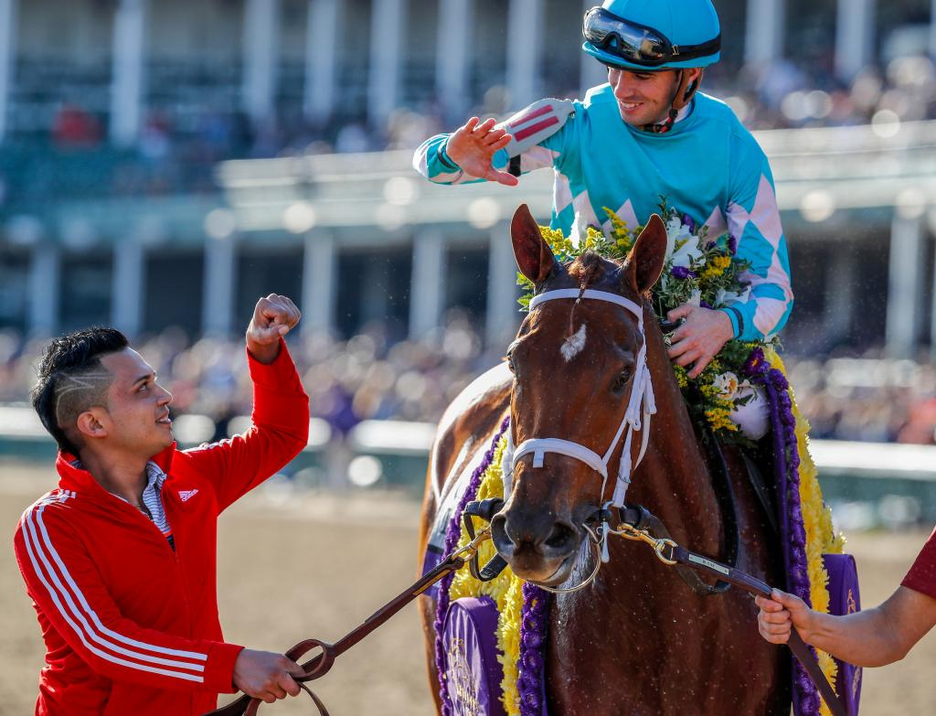 Fist bump – or high five? – for Florent Geroux after Monomoy Girl dazzles in the Distaff. (Eclipse Sportswire)