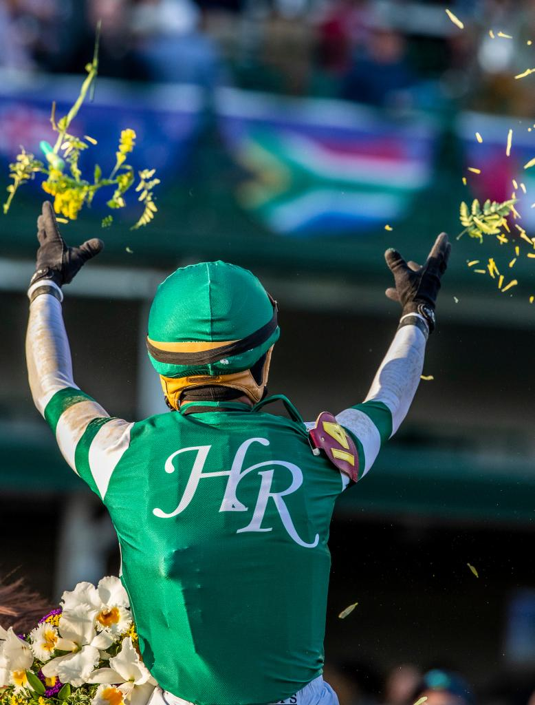 Joel Rosario celebrates his third win in the 2018 Breeders' Cup with a flower toss. (Eclipse Sportswire)