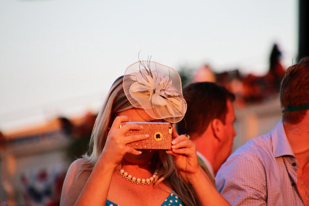 Catching the winner of the final race with her phone. (Julie June Stewart photo)
