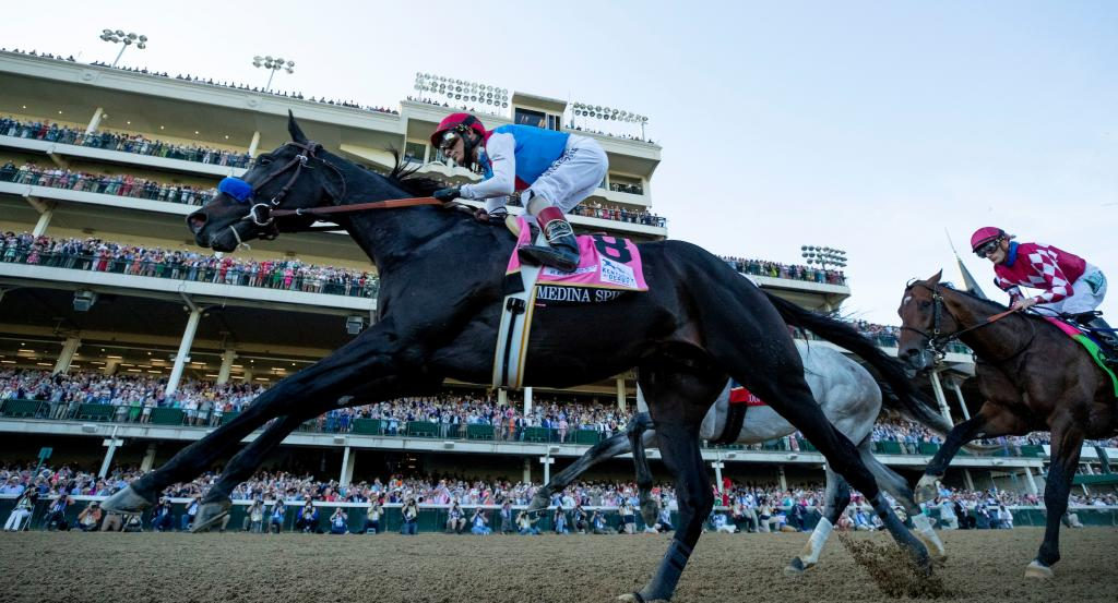 The horses pass the finish line for the first time in the 2021 Kentucky Derby. (Eclipse Sportswire)