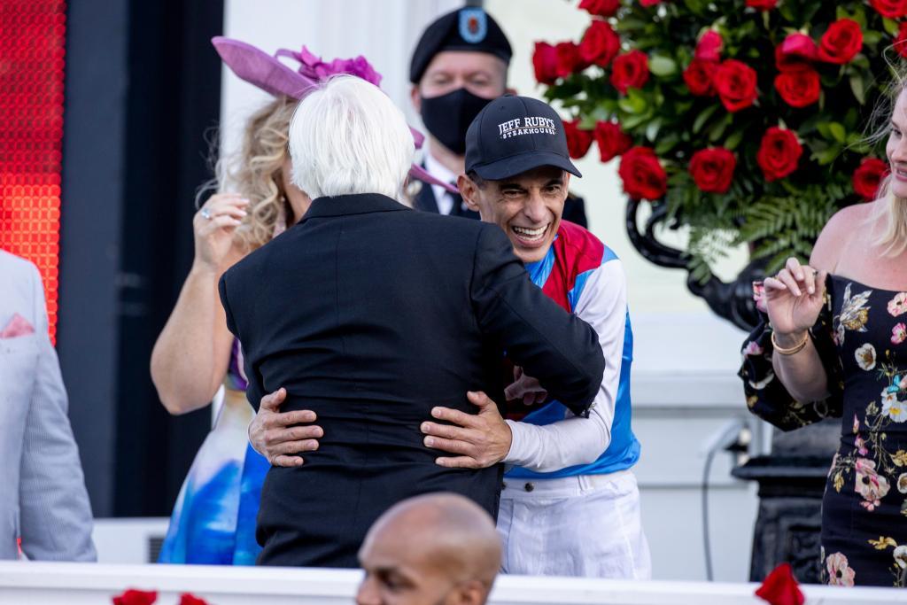 Kentucky Derby-winning jockey John Velazquez hugs winning trainer Bob Baffert.. (Eclipse Sportswire)