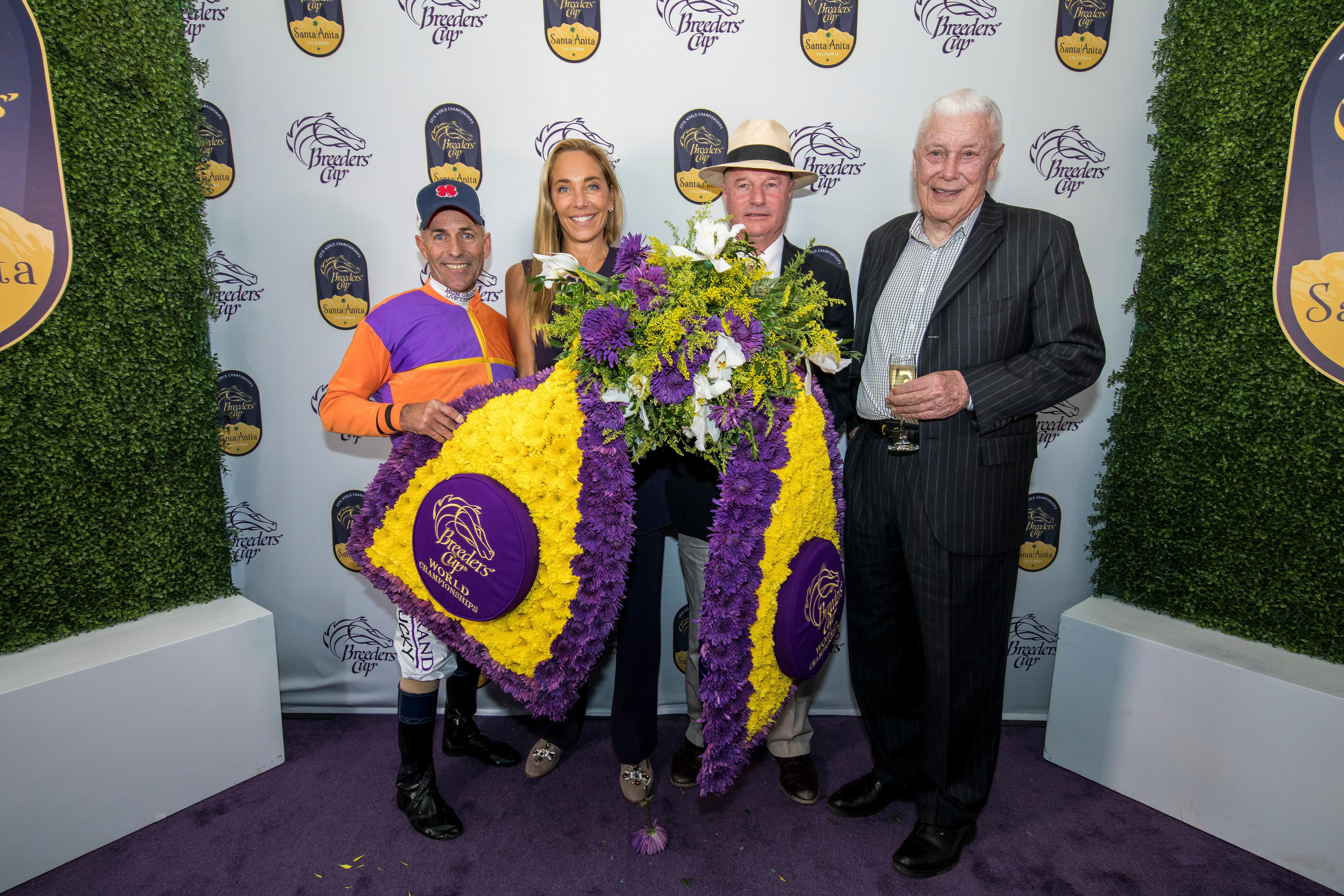 The connections of Beholder celebrate their 2016 Distaff win.
