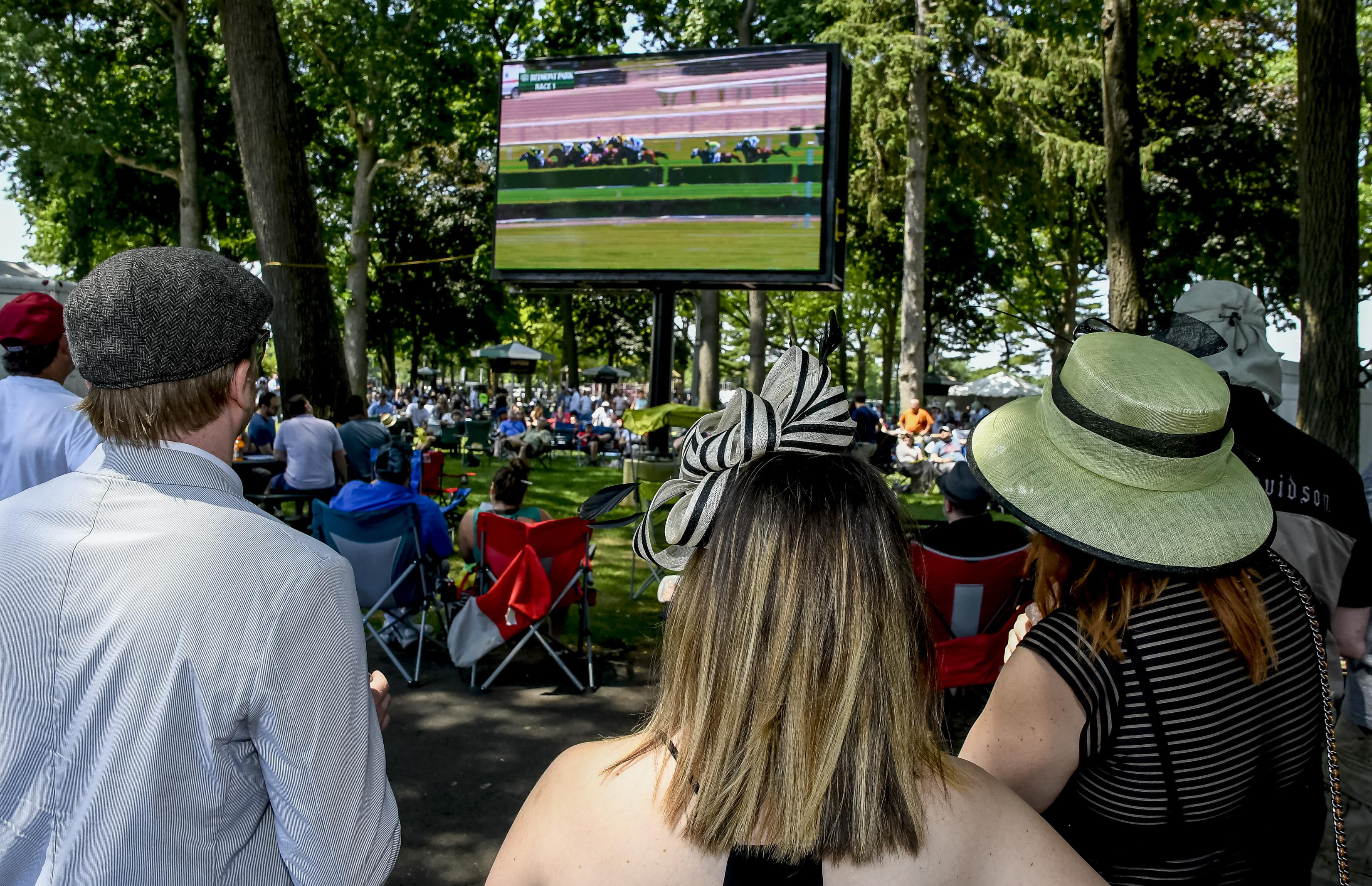 Fans watch Belmont day racing from the backyard.