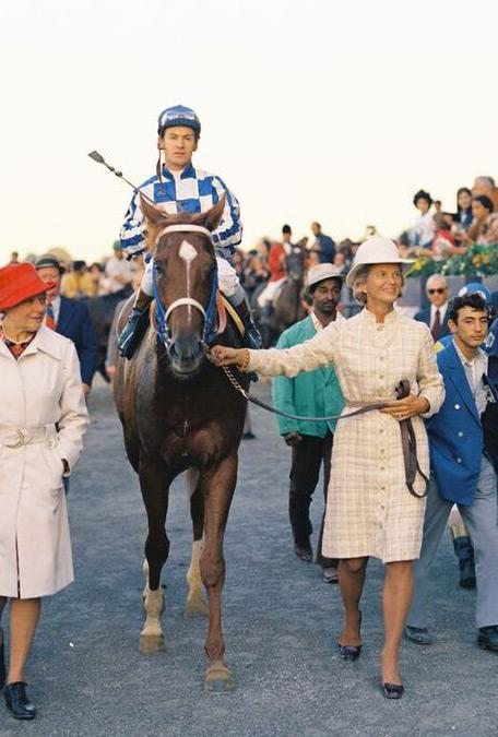 Chenery leads Secretariat into the Belmont Park winner's circle.