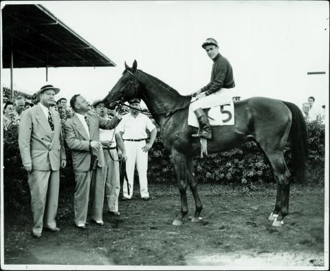 Citation and Snider after winning the Flamingo Stakes.