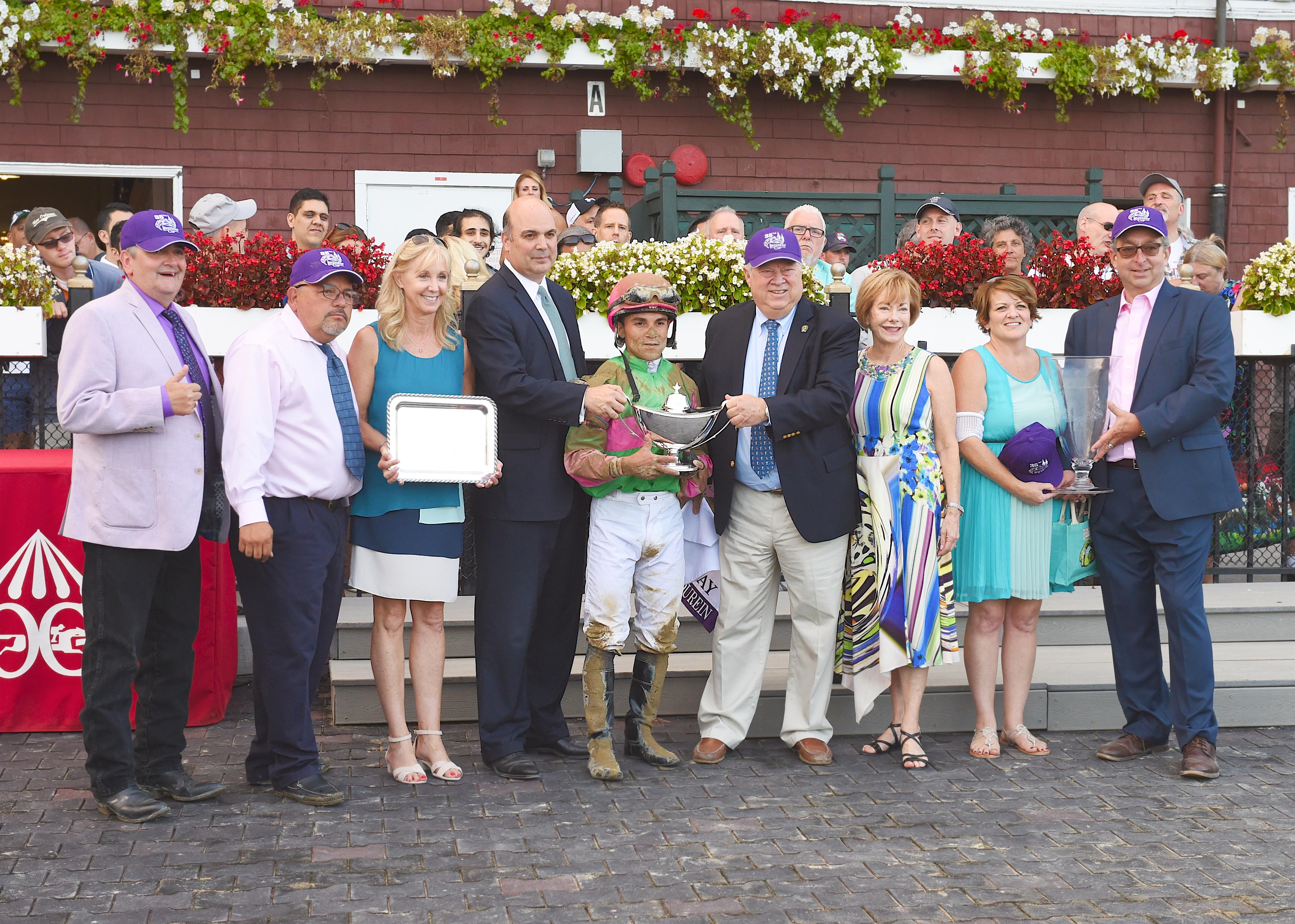 Contessa (right) in the Spinaway winner's circle.