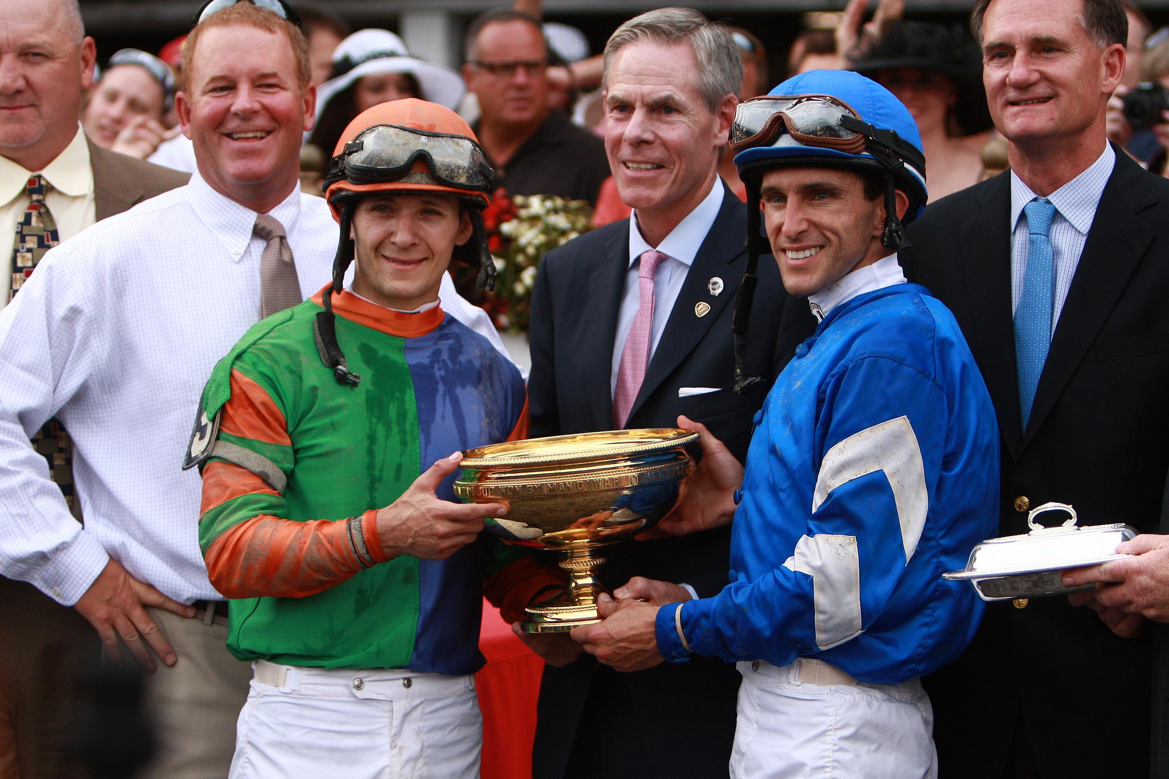 Ramon Dominguez holds the Travers trophy.