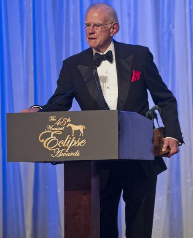 Farish accepts Honor Code's 2015 Eclipse Award.