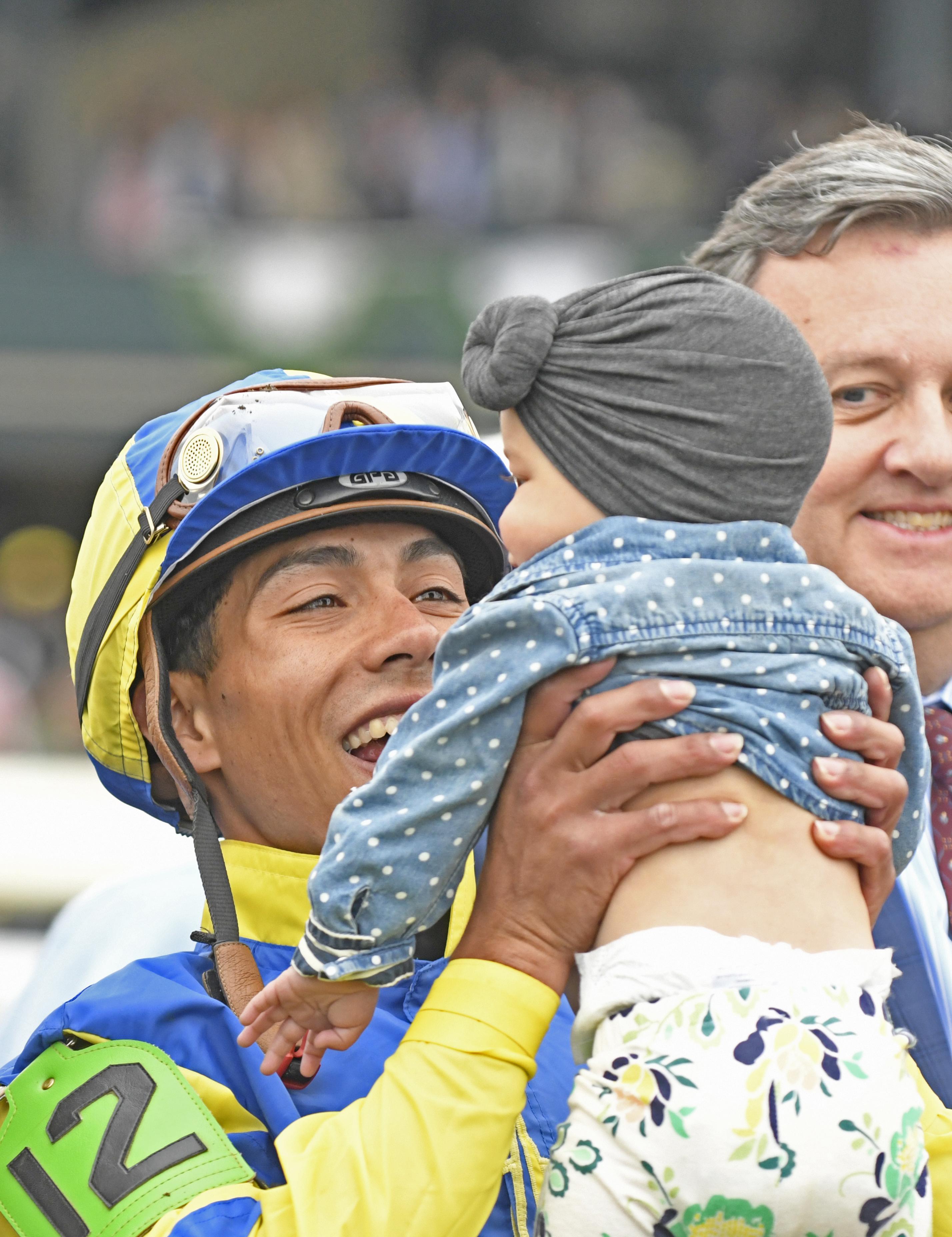 Ortiz and his daughter Leilani