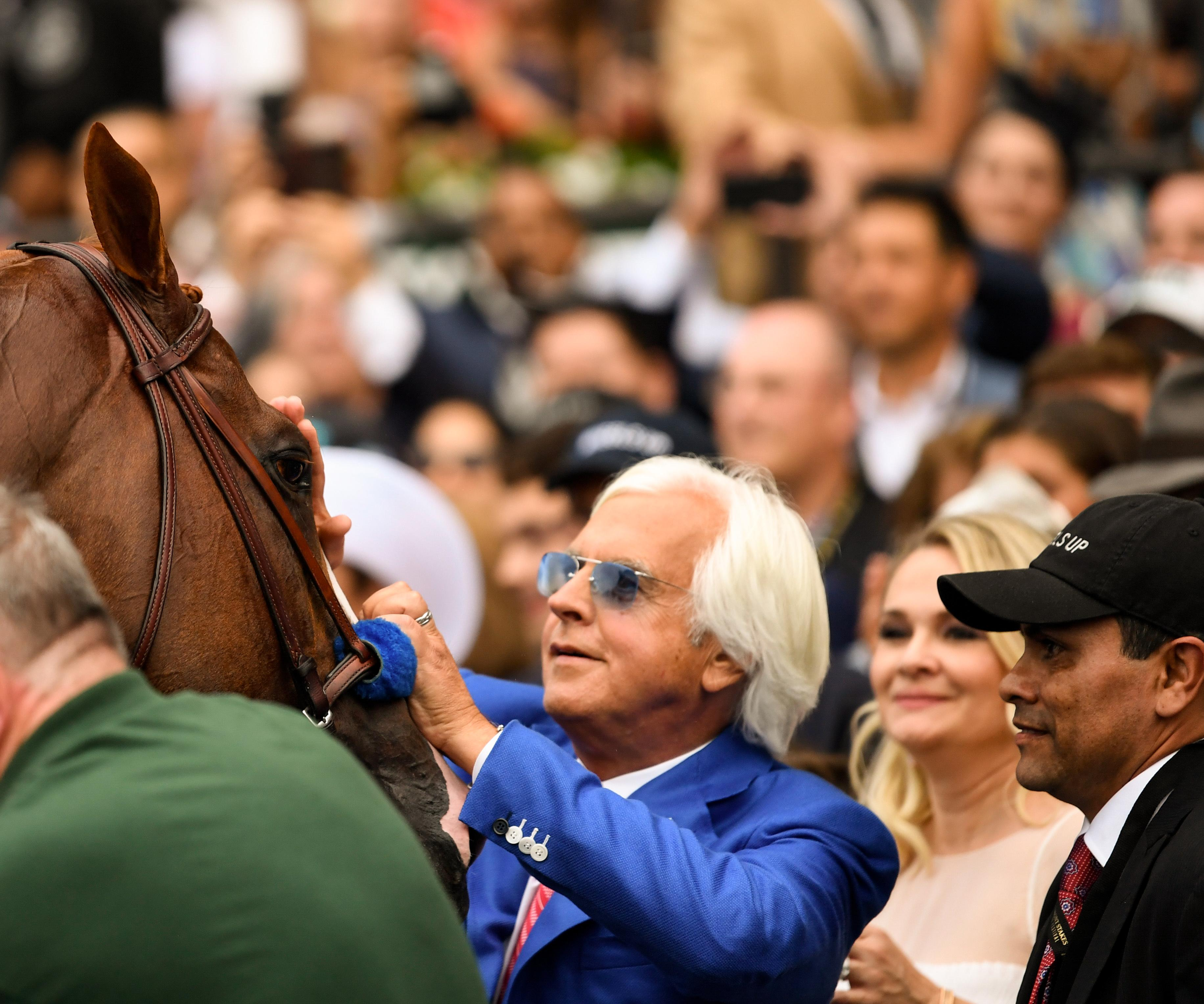 Baffert pats Justify after the Belmont.