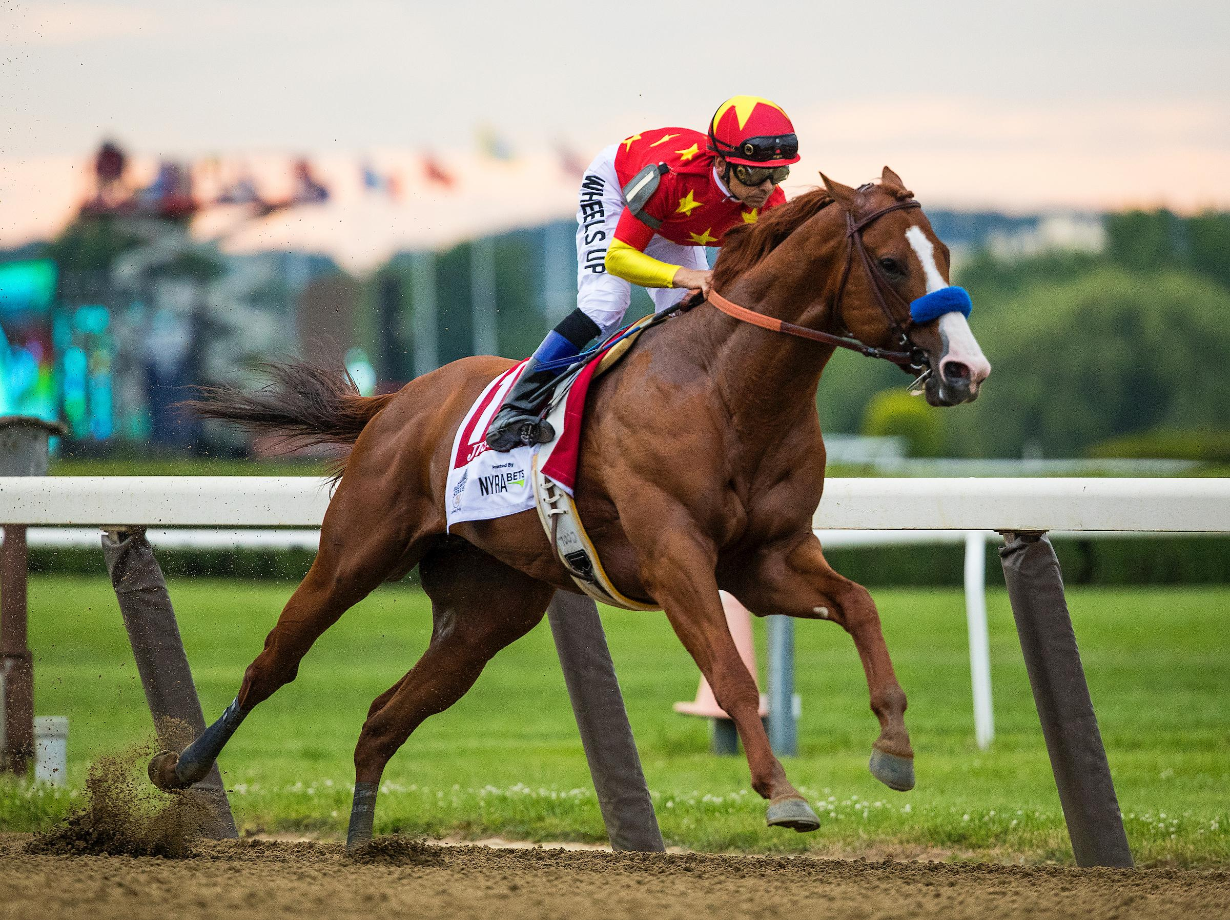 Justify en route to winning the Belmont Stakes.