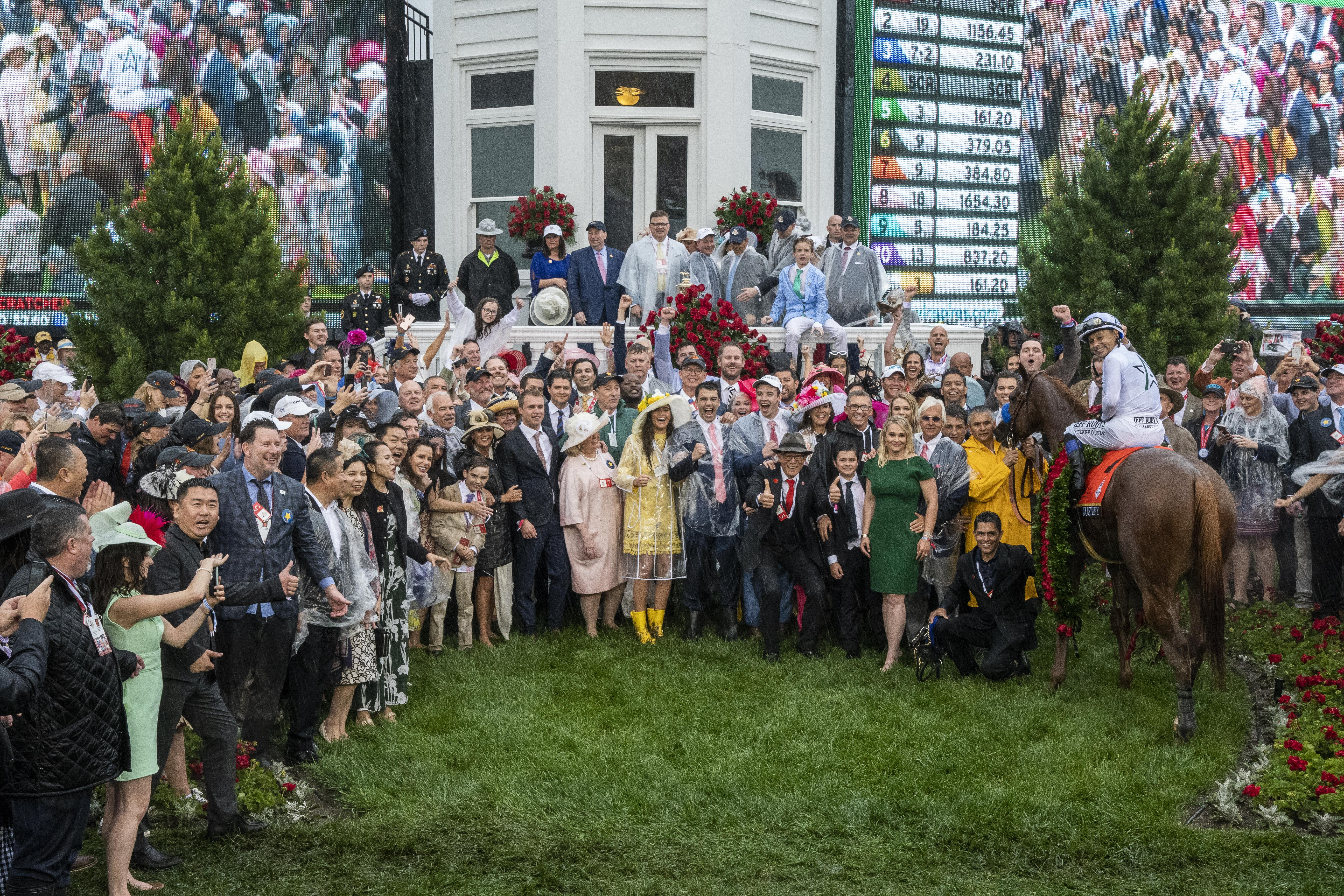 The crowded 2018 Kentucky Derby winner's circle.