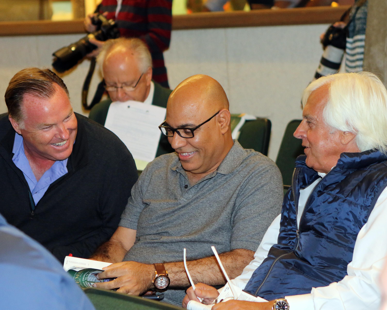 Ludt (left) with Amer Abdulaziz and Bob Baffert at the Keeneland September sale.