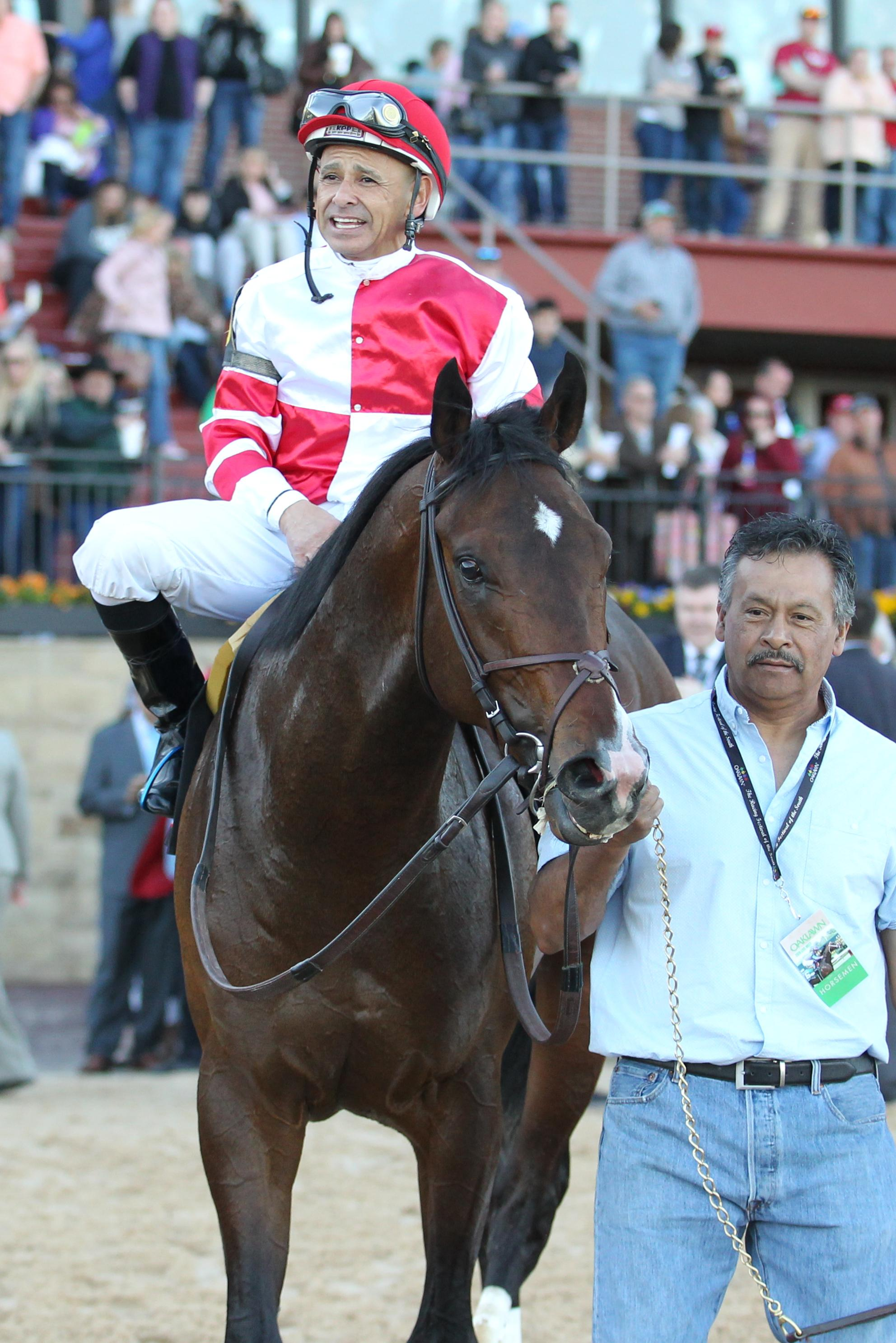Omaha Beach and Mike Smith enter the winner's circle.