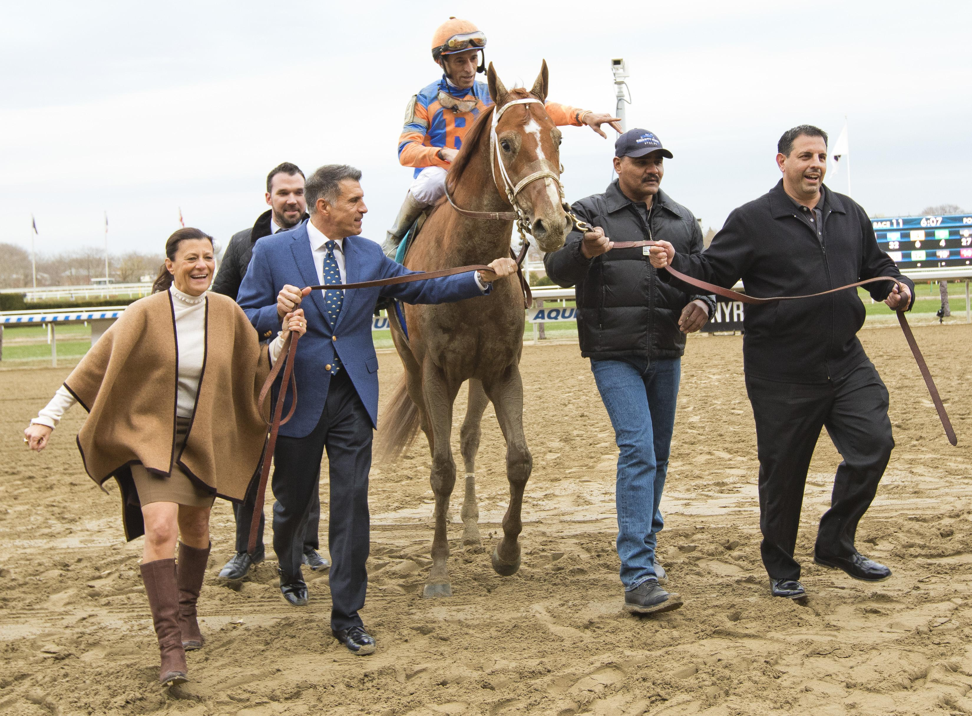 Viola and Repole lead Vino Rosso into the Aqueduct winner's circle.