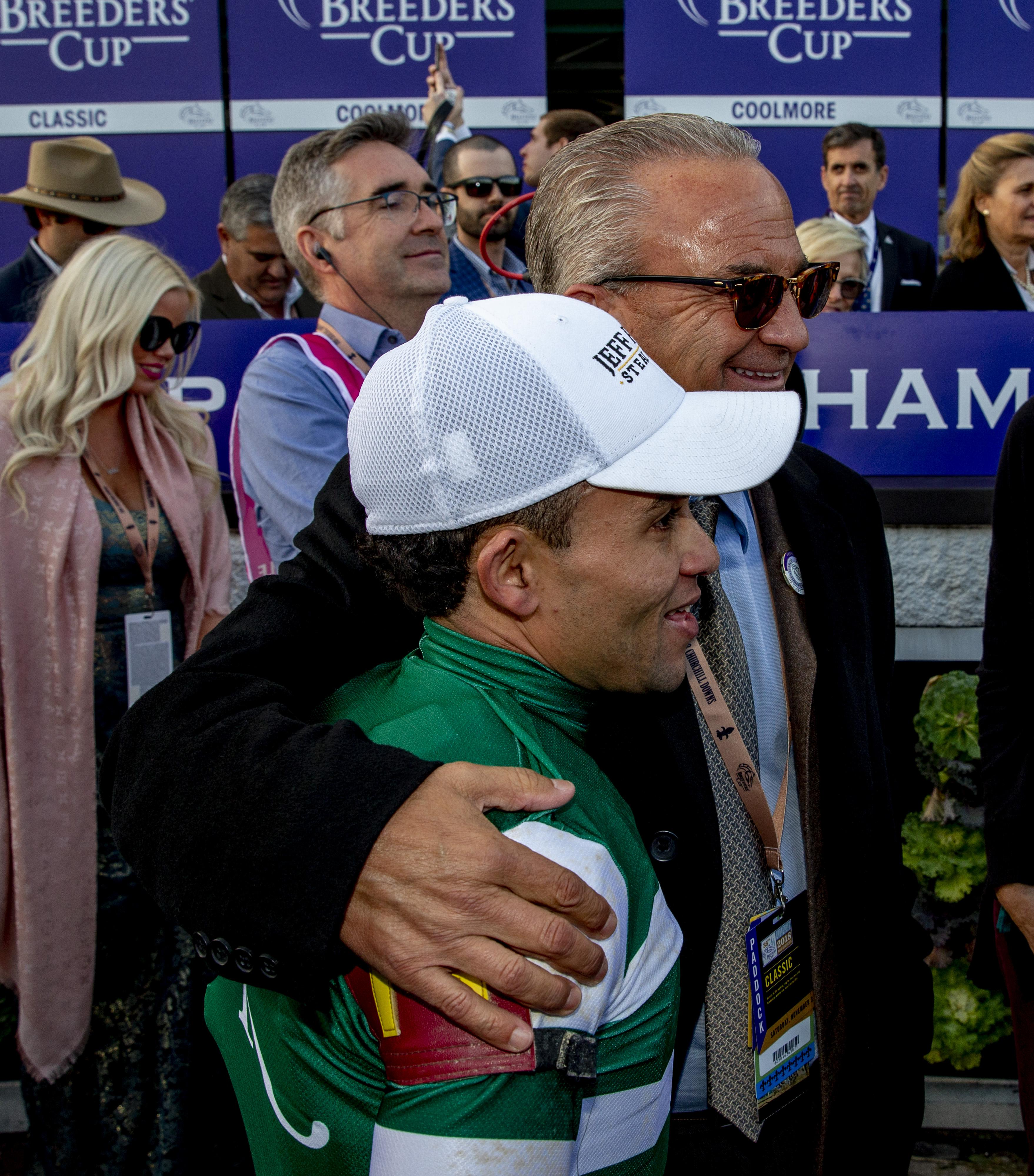 Jockey Joel Rosario and owner Kosta Hronis celebrate Accelerate's win.