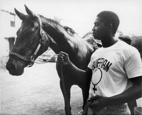 Ruffian and regular exercise rider John Truesdale at Belmont Park, 1975.