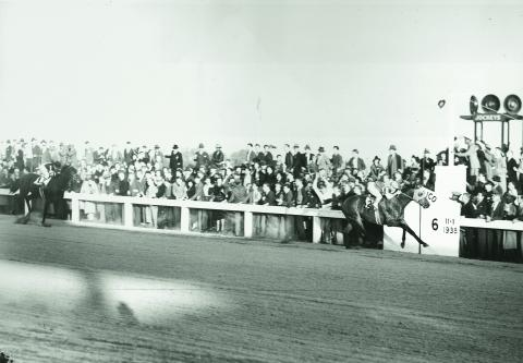 Seabiscuit soundly defeats War Admiral in a match race at Pimlico in November 1938.