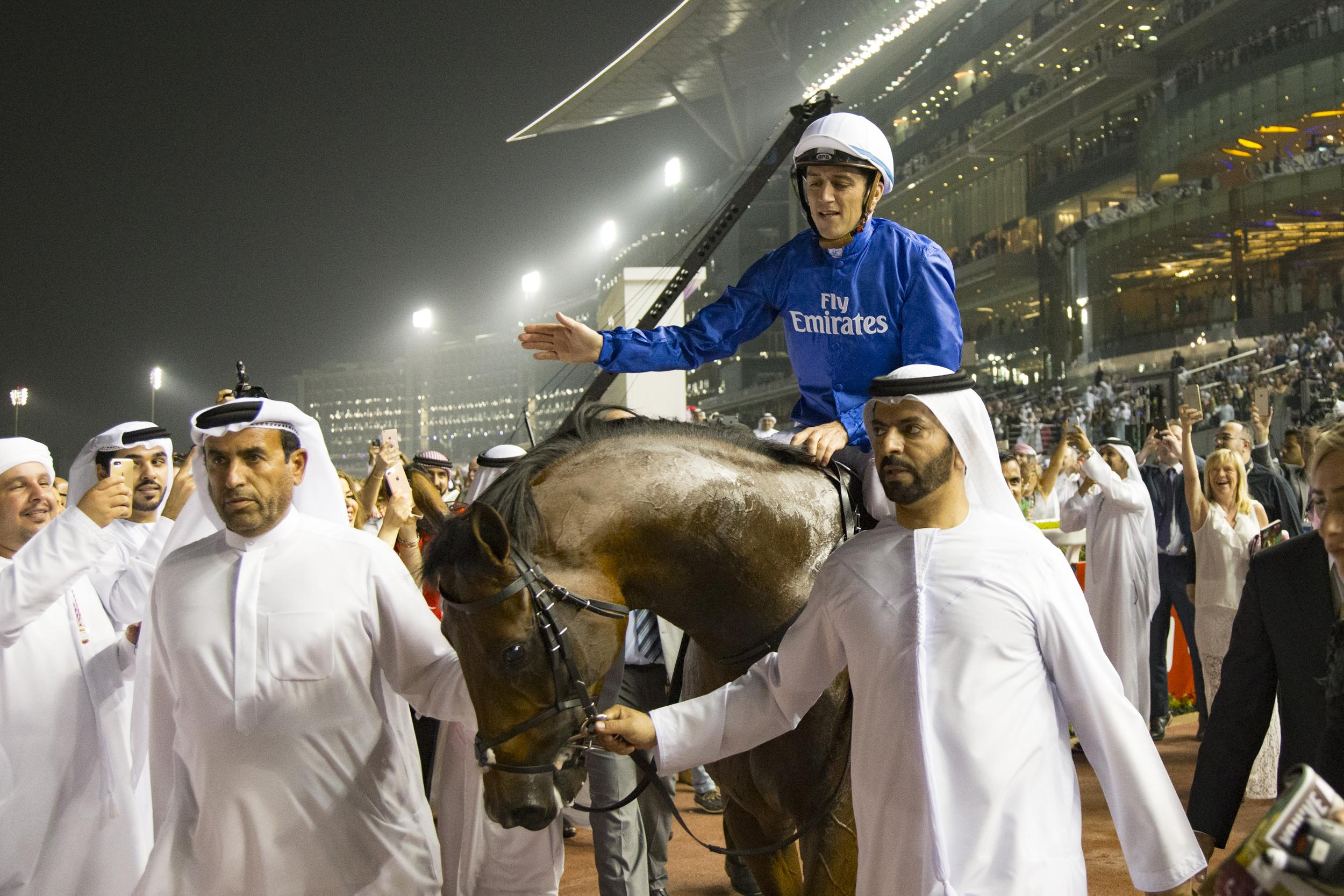 Thunder Snow and his Godolphin team enter the winner's circle.